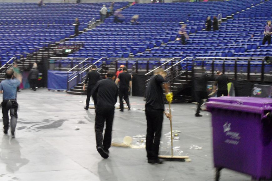 Cleaning up the standing area.