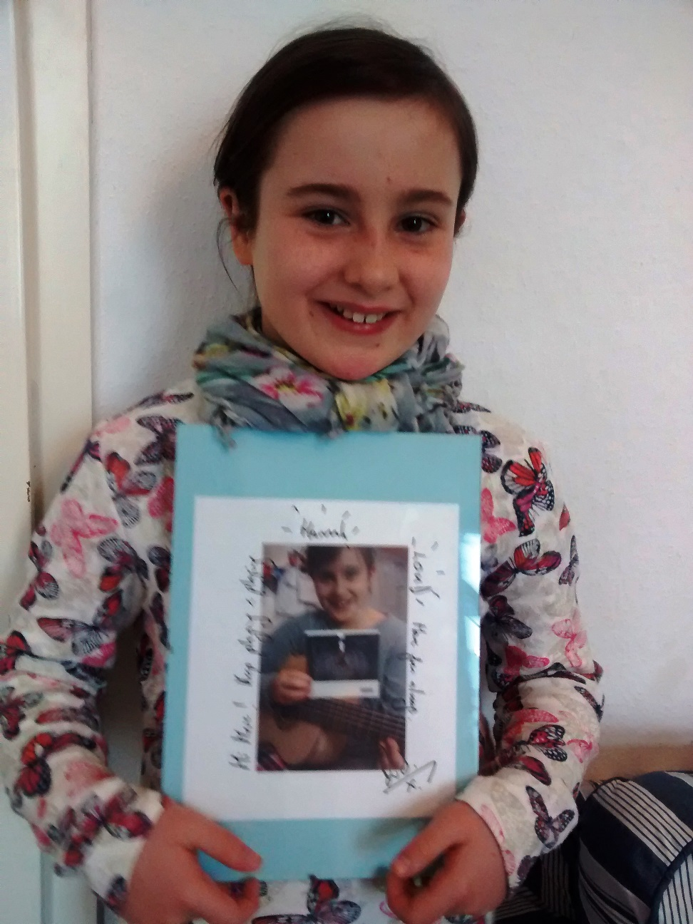 Hannah with her signed photo - proud & happy!